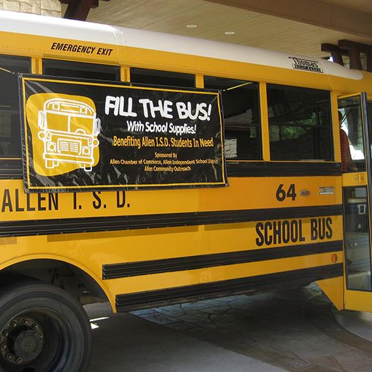 Picture of school bus with Fill the Bus banner on it